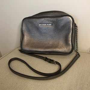 Silver Michael Kors crossbody purse- gently used